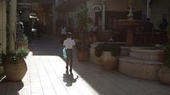 Jewish religious woman walk with her children in Zikhron Ya'akov Stock Footage