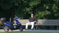 Man sitting on a bench, Berlin Stock Footage