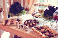 Love letters decor on table with sweets and fruits Stock Photos