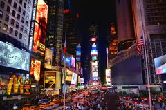 NEW YORK CITY, USA - OCTOBER 17, 2014: People on Times Square at night. Times Kuvituskuvat
