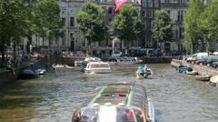 Canal boats in Amsterdam, Holland Stock Footage