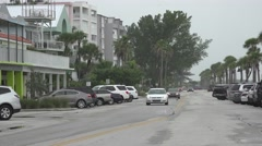 Cars Drive Down Street Florida Beach Town Foggy Day Stock Footage