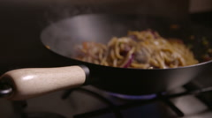 Noodles and Vegetables Cooking in Wok on a Stove Stock Footage