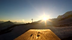 The slanting rays of the setting sun on a wooden walkway over the tops Stock Footage