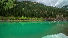 4K TimeLapse. A reflection on the water in the lake Kaindy in Tien Shan mountain Stock Footage