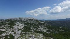 Fly over Drone shot revealing mountain landscape 4K Establishing shot Stock Footage
