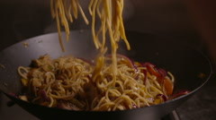 Tossing Noodles and Vegetables in Wok on a Stove 2 Stock Footage
