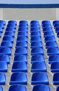 sector of the stadium with blue armchairs with a place for the l - stock photo