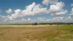 Military vehicles driving on a country road Stock Footage