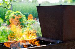 Fire in the brazier on vacation in the cottage - stock photo