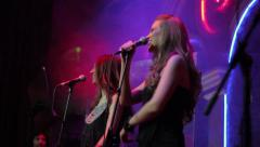 Two young girls singing on Beck vocals. Show business, singer, jazz Stock Footage