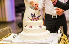 White wedding cake with pink and  flowers Stock Photos