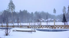 General view of the ski resort in Siberia In a blizzard. Wooden houses at forest Stock Footage