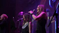 Girls sing at Beck vocals. Show business, singer, jazz Stock Footage
