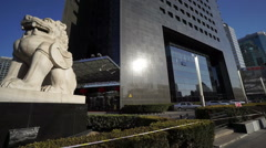 The couple of marble lion sculpture in Beijing Financial Street,China. Panning Stock Footage