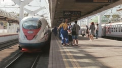 Passengers boarding the train sapsan Stock Footage