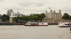 Sightseeing boat in front of the tower of London Stock Footage