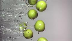 apples are flying in jets of water - stock footage