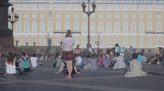 The guitarist plays in the Palace Square , tips  people listening to music Stock Footage