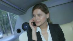 Stock Video Footage of attractive businesswoman talking on the phone sitting in car