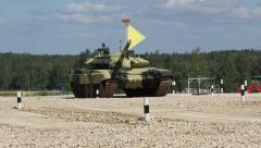 Tank with a yellow flag. Biathlon Alabino Stock Footage