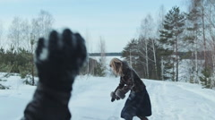 Couple having snowball fight in snow in winter forest, slowmotion Arkistovideo