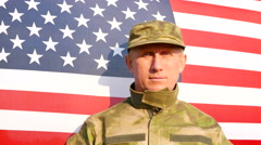 Soldier salute against American  flag. Face close up. 4K shot 3840x2160 Stock Footage