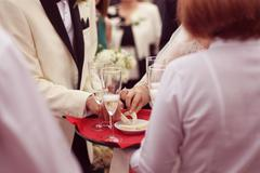 Waiter serving for a wedding - stock photo