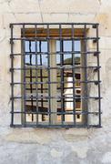 Wrought iron grille window - stock photo