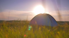 Man stand near camping tent on the hill by picturesque landscape background Stock Footage