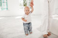 Young father with his nine months old son at home Stock Photos