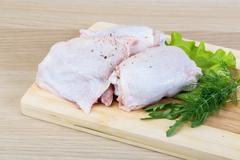 Raw chicken thighs - stock photo