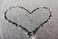 painted heart snow - stock photo