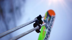 Skiing with ski poles lifts climb to the blurred background of snow in the Stock Footage
