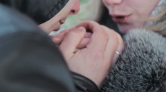 Boyfriend warms hands sweetheart, frozen in the cold Stock Footage