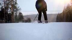 skier ride the mountain and disappear from the horizon - stock footage