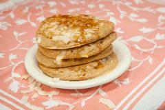 Whole Grain Coconut Pancakes with Maple Syrup - stock photo