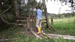 Man in Rubber Boots and a Gate Stock Footage