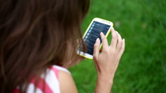 Beautiful young woman writing sms on smartphone - stock footage