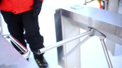 Friends with snowboards go through Peak station entrance fee for ski lift Stock Footage