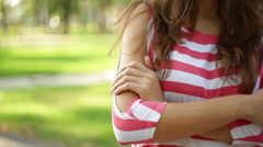 Hands of a single woman in a park Stock Footage
