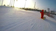 Snowboarder dressed kigurumi takes a picture from his camera  in the mountains Stock Footage