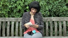 Slow motion. Pretty young woman happily counting UK sterling notes. - stock footage