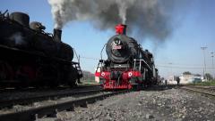 Steam locomotive driving on railway,emitting heavy smoke Stock Footage
