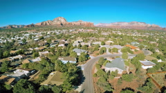 Stock Video Footage of Aerial view of Sedona, Arizona and Red Rocks formations