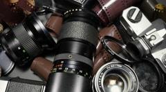 VINTAGE 35mm STILL CAMERAS & LENSES.  HD Stock Footage