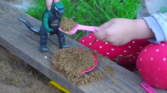 A child playing in the sandbox - stock footage
