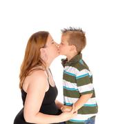 Mother kissing her little boy. Stock Photos
