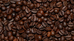 WHOLE COFFEE BEANS IN TRACKING SHOT.   Stock Footage