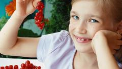 Girl showing a sprig of red currants Stock Footage